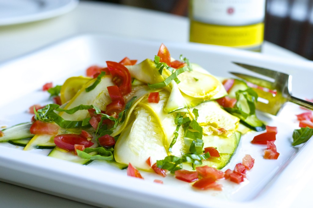 Colorful zucchini salad with ribboned zucchini, red pepper, herbs and more.