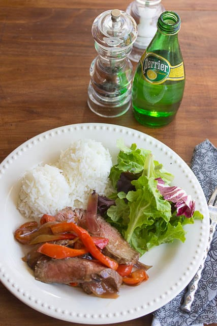 dinner plate with beef stir fry, rice and salad