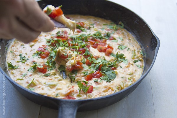 A simple queso loaded with tomato, onion, and peppers