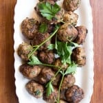 Italian meatballs make an easy dinner or can be made in bulk for an easy party dish with rolls