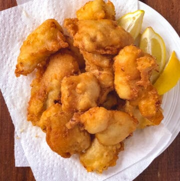 plate of fish fry with lemon wedges ready to eat