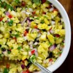 This healthy pineapple salsa is perfect for snacking on with chips or is delish as a topping for grilled fish!