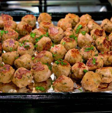 baked turkey meatballs on tray on stovetop
