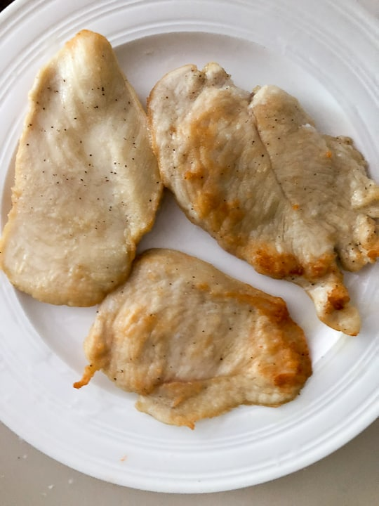 plate of cooked chicken breast
