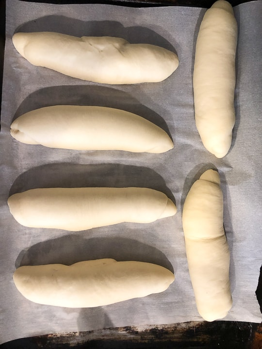 sandwich rolls about to be baked