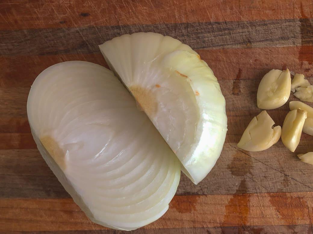 chopped onion and peeled garlic