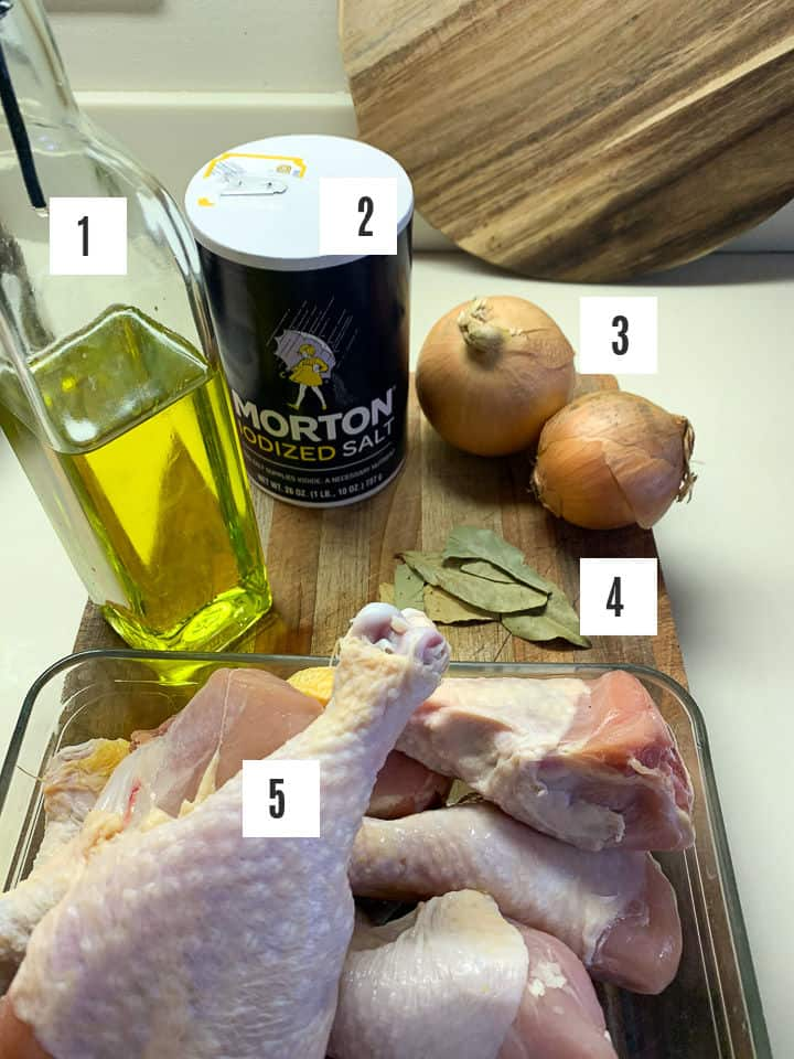 photo of chicken stock ingredients including oil, salt, onion, bay leaves, and chicken drums