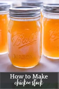 front view of four pint size glass ball jars filled with fresh chicken stock