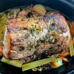 philadelphia roast pork ready to be sliced in granite ware pan