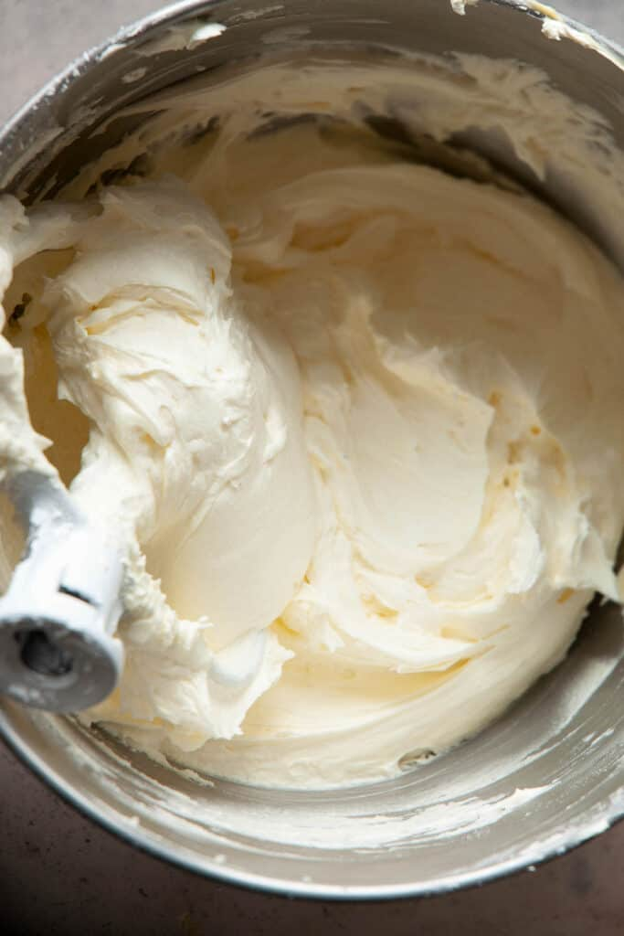 overhead view of vanilla buttercream frosting in silver mixing bowl
