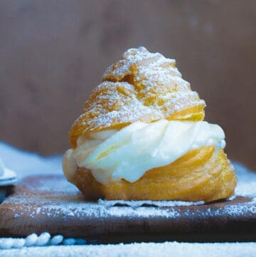 side view of italian cream puff with ricotta filling