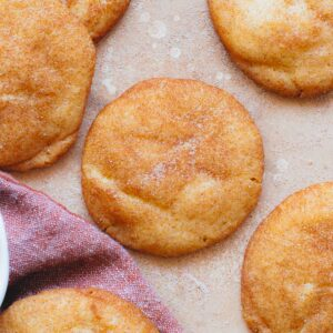 overhead view of snickdoodle cookie with purple cloth napkin