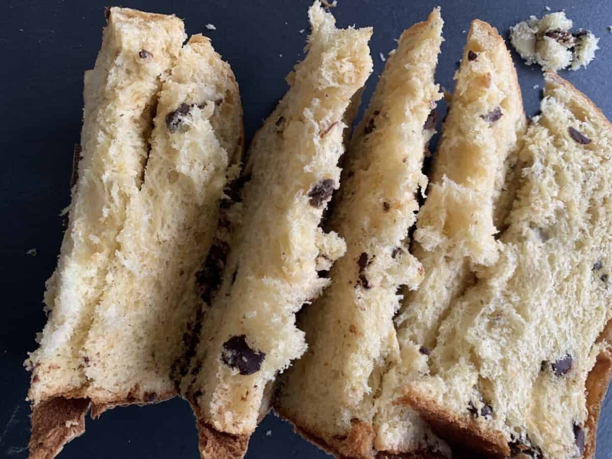slices of panettone on black background