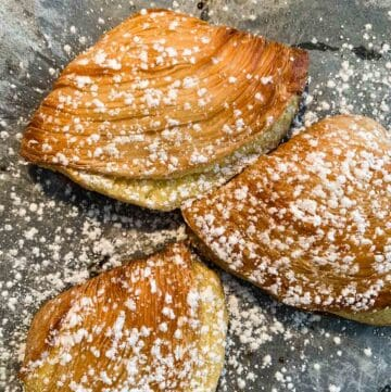 sfogliatelle with powdered sugar