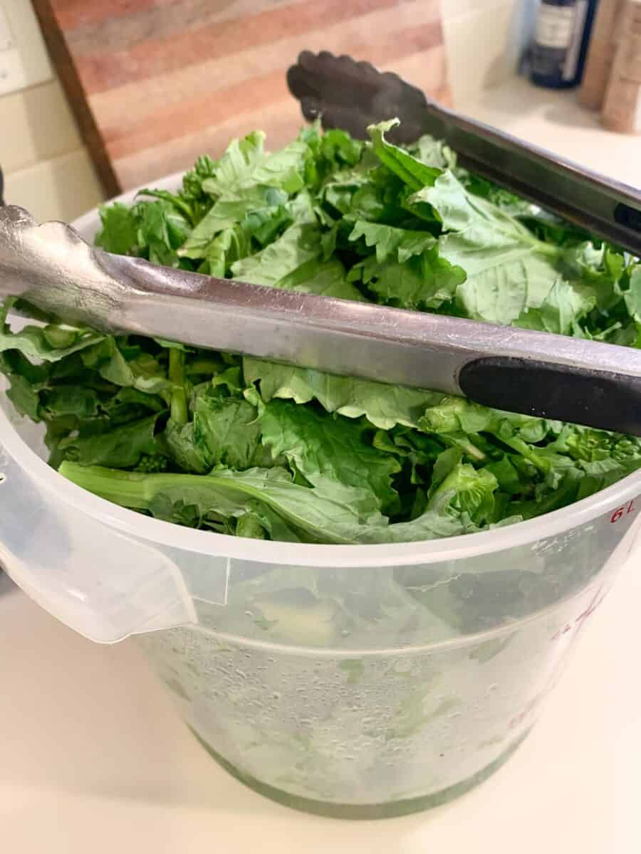 bucket of cleaned trimmed broccoli rabe
