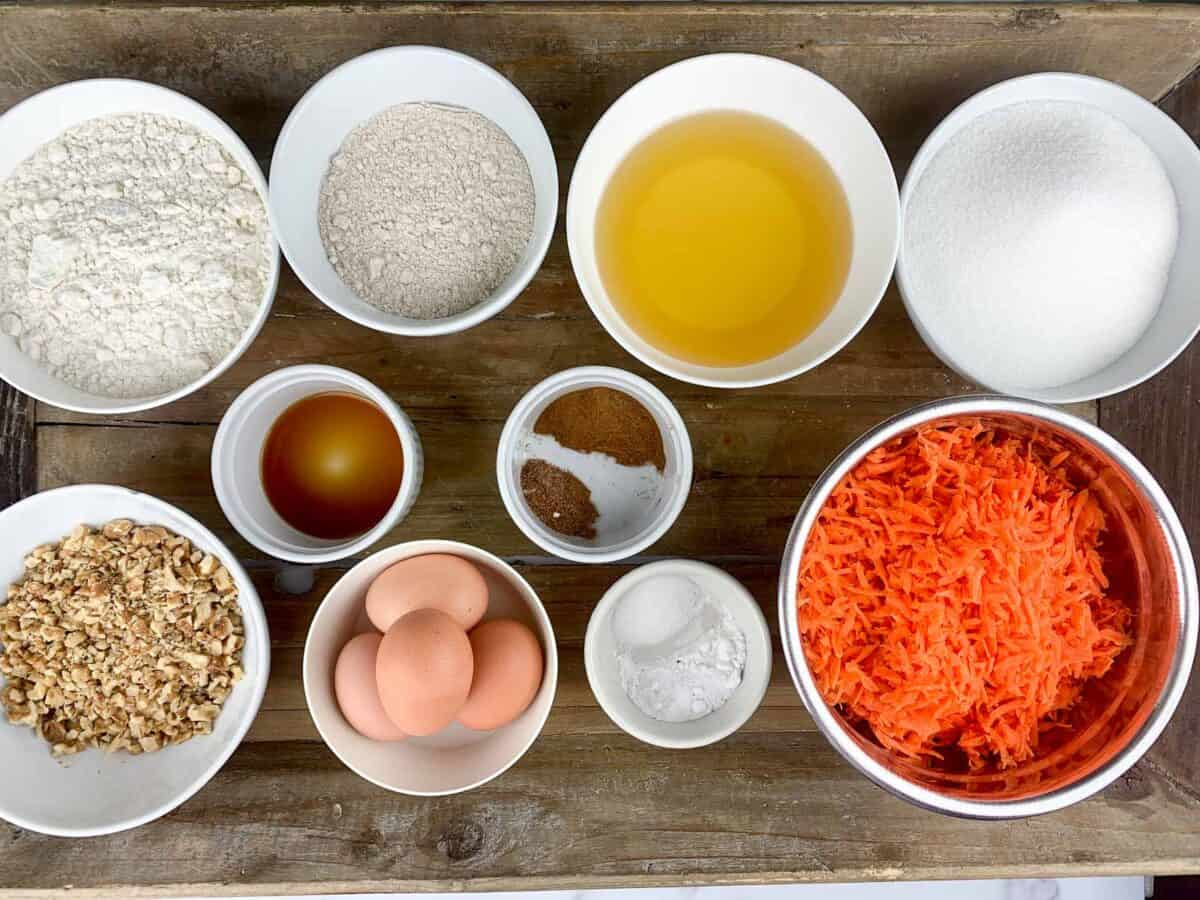 overview of carrot cake ingredients measured out shown on wooden tray. How to Make the Best Carrot Cake Ever