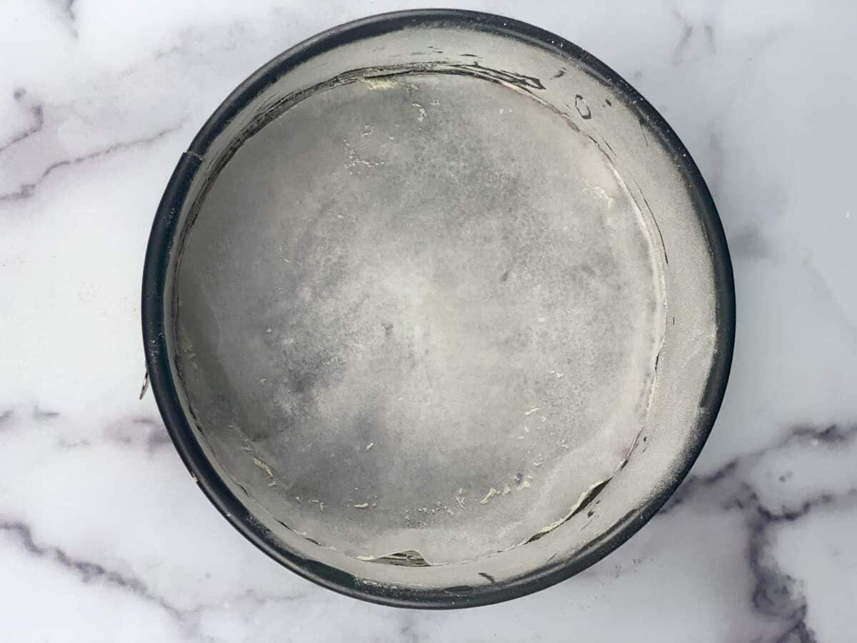 springform pan, dusted with flour and butter ready for cake batter