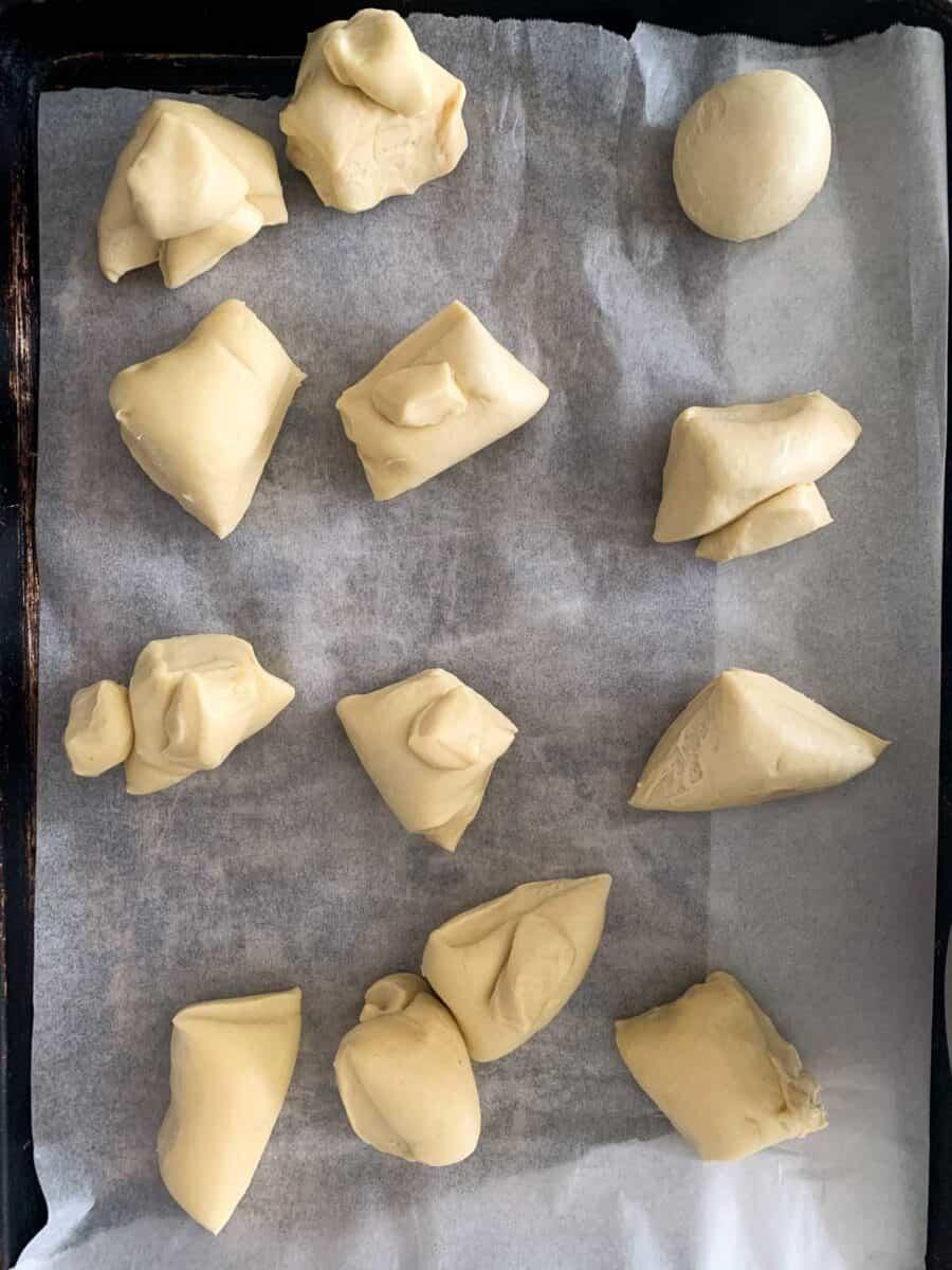 pieces of kolache dough on parchment paper