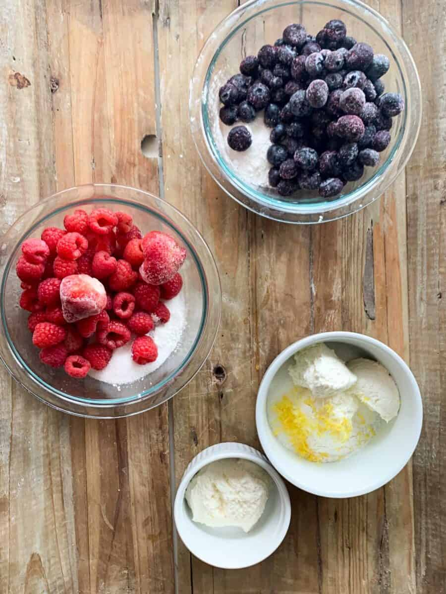 kolache filling ingredients for fruit or cheese filling in bowls on wood background