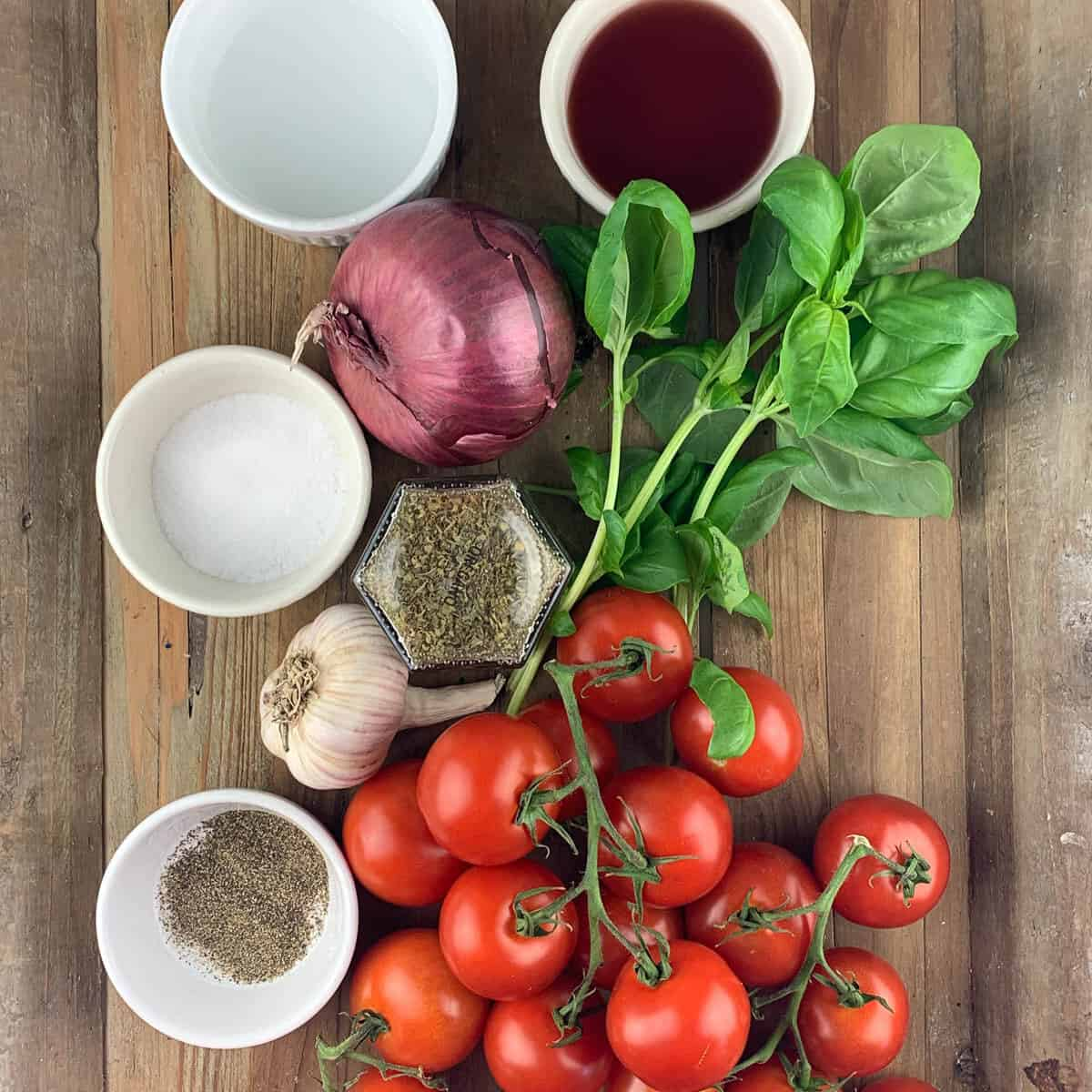 overview of tomato salad ingredients on wooden background