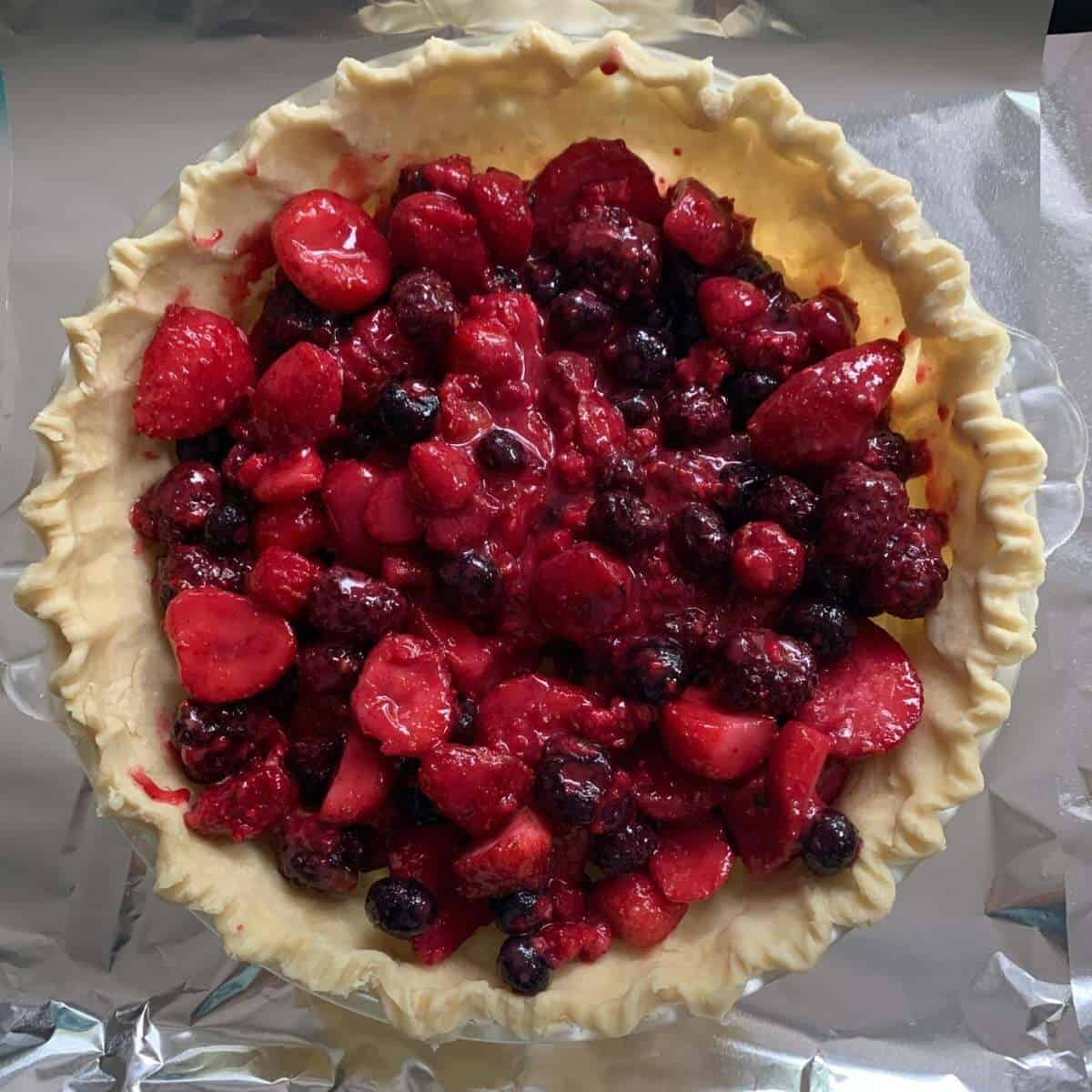 unbaked mixed berry pie top view
