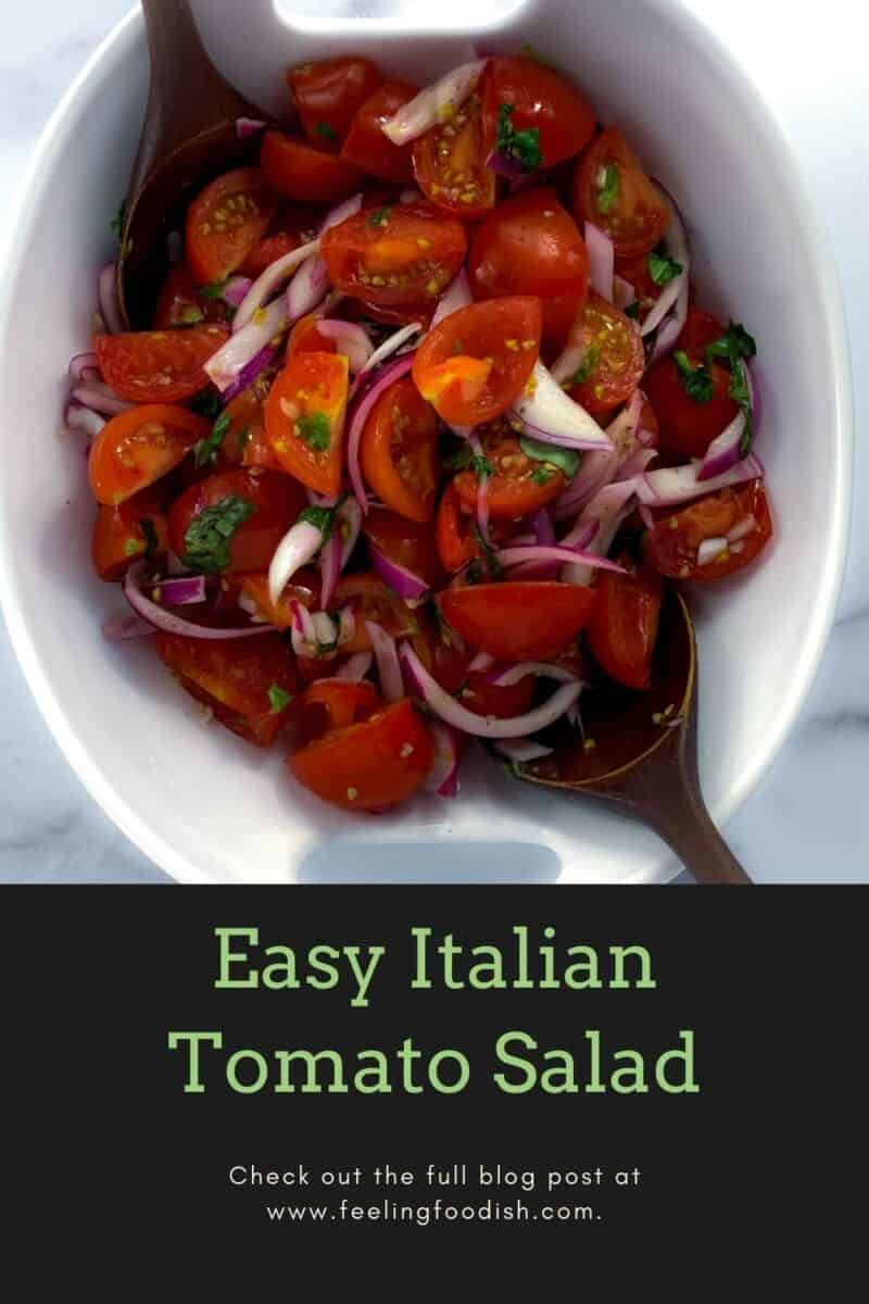 top view of italian tomato salad in white bowl