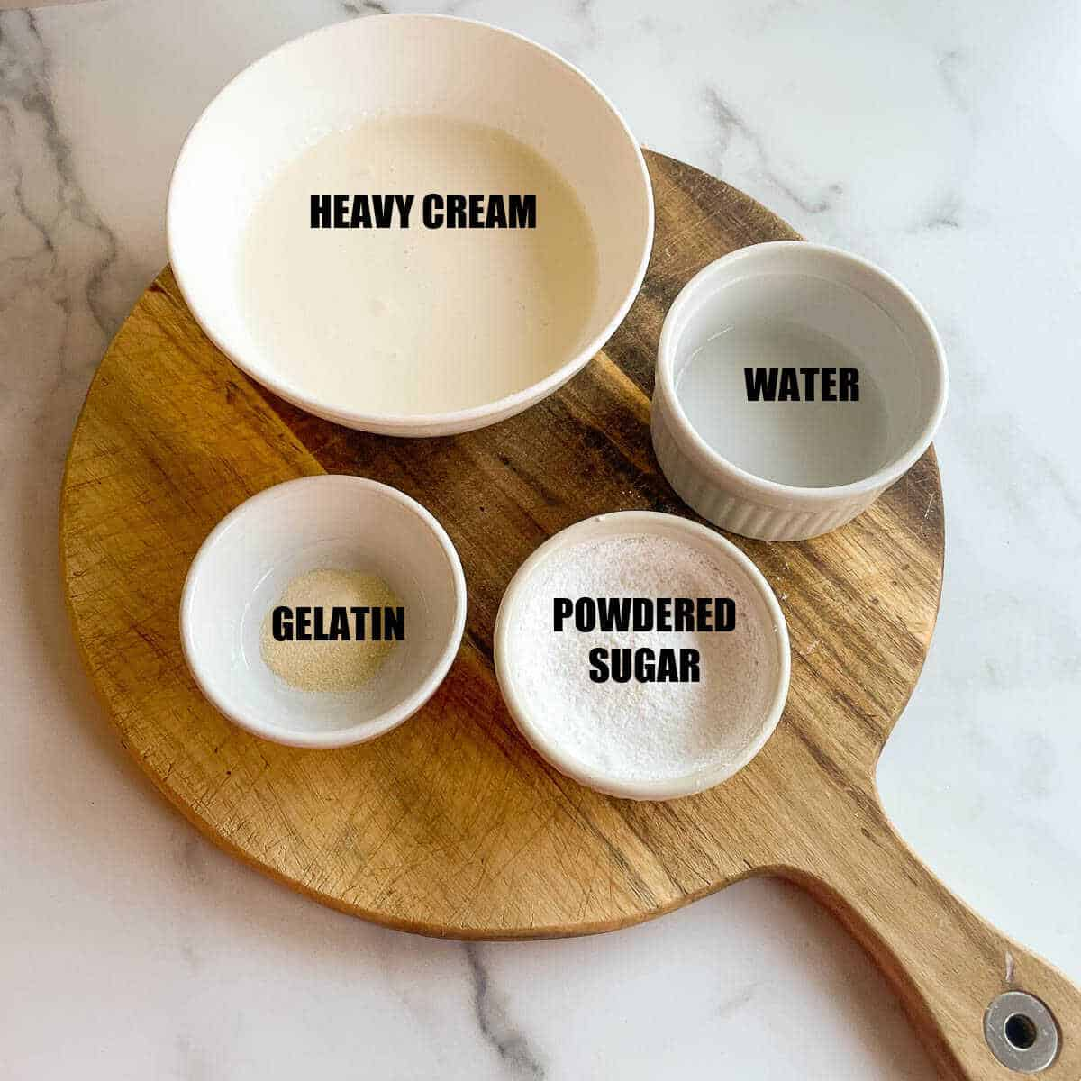 wooden board with ingredients for stabilized whipped cream