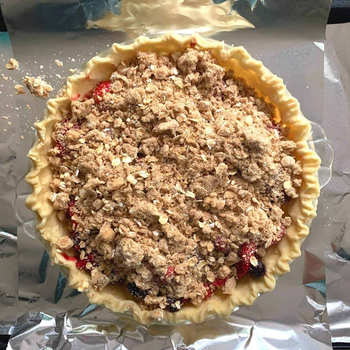 mixed berry pie ready to be baked