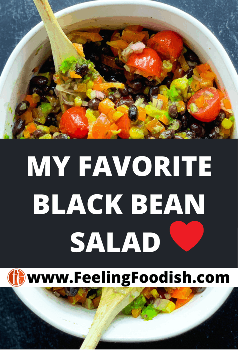 black bean and corn salad in white serving bowl with spoons