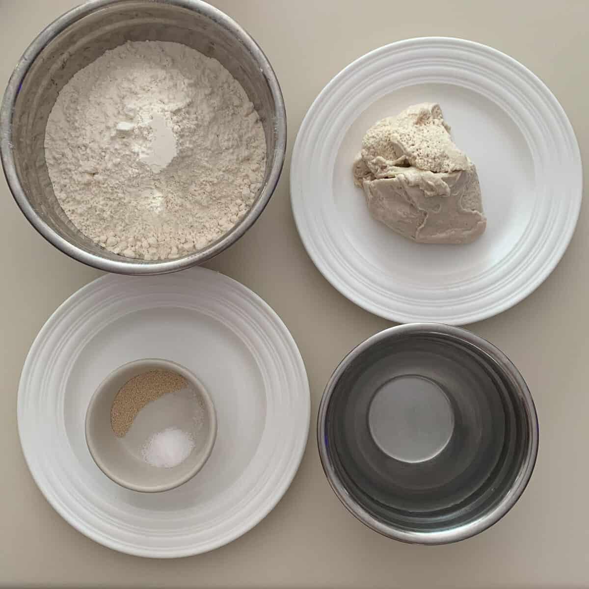 Bialys dough ingredients shown in bowls