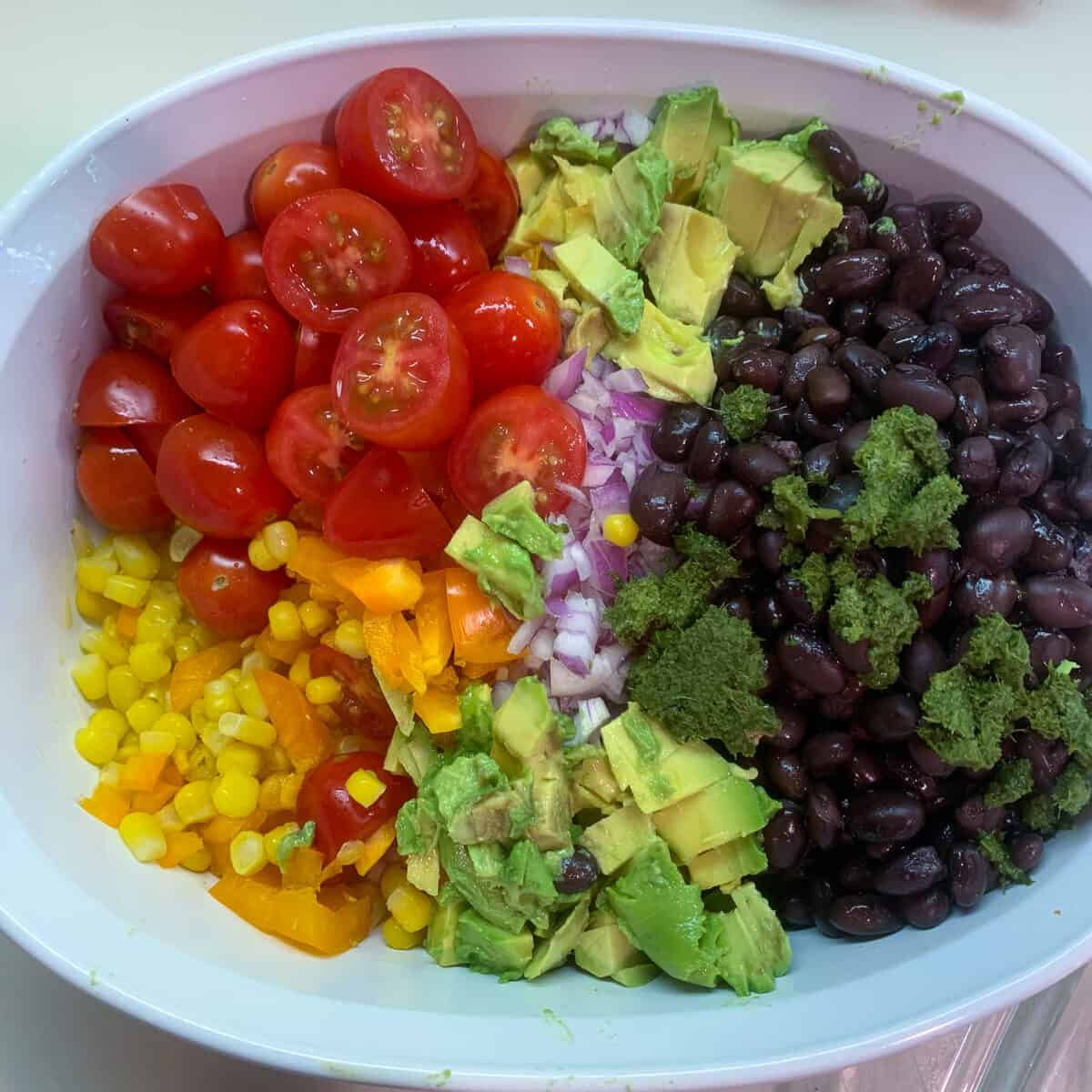all ingredients for black bean salad ready to be mixed