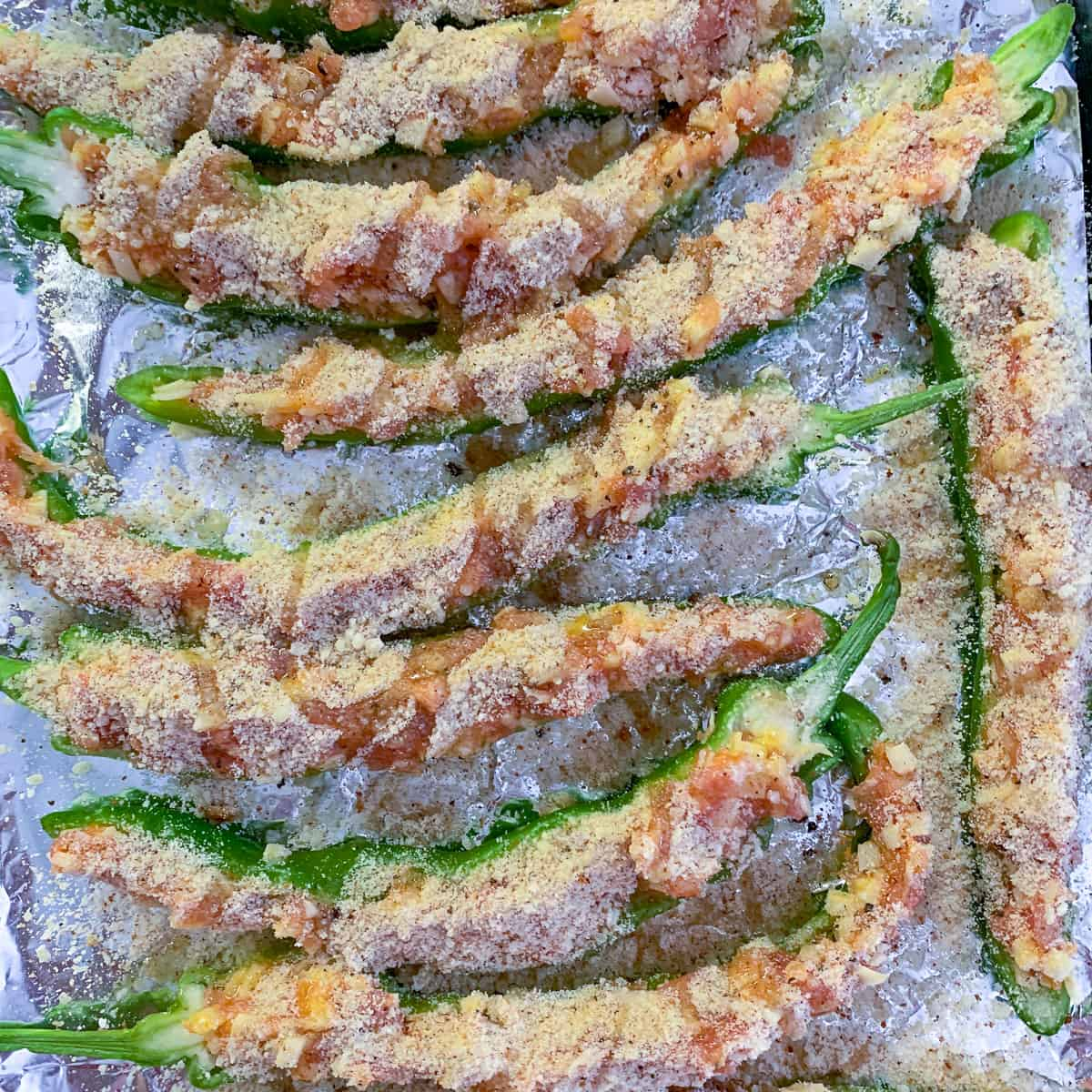 stuffed Italian long hots drizzled with olive oil ready to be baked or grilled