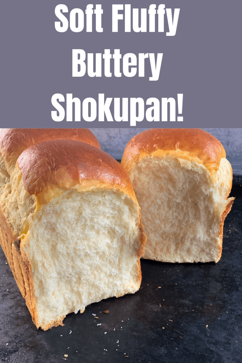 shokupan bread cut in half on black tray