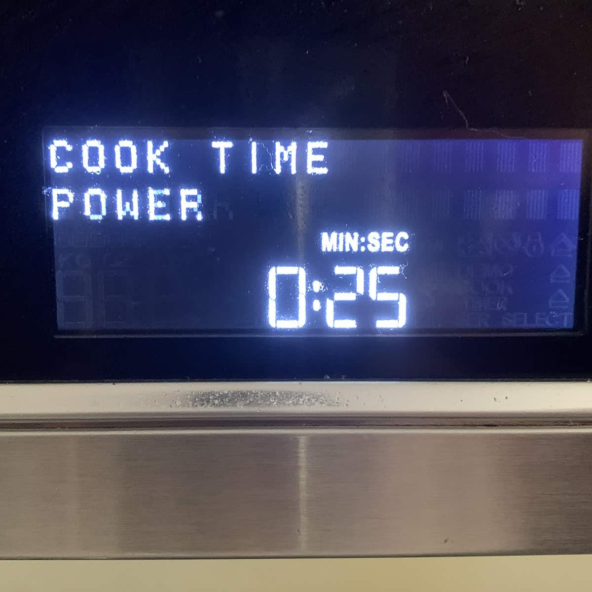 view of microwave timer set to 25 seconds
