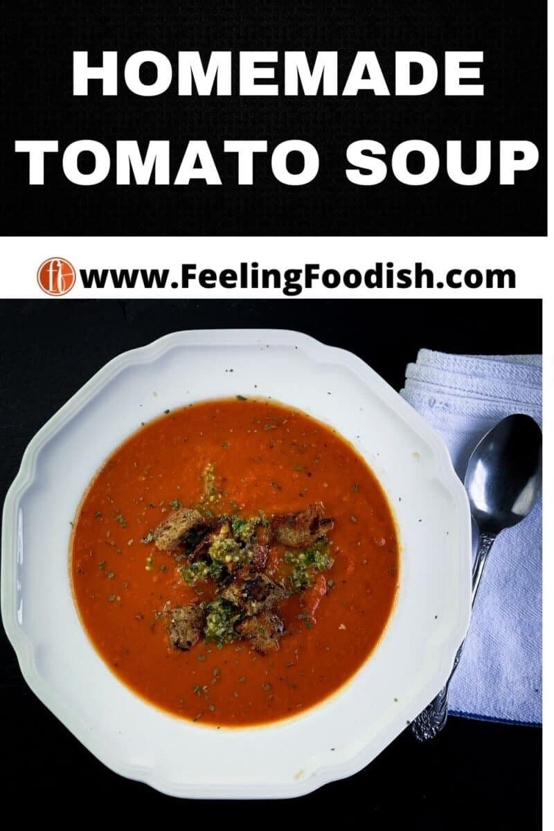 tomato soup in white bowl with croutons and pesto