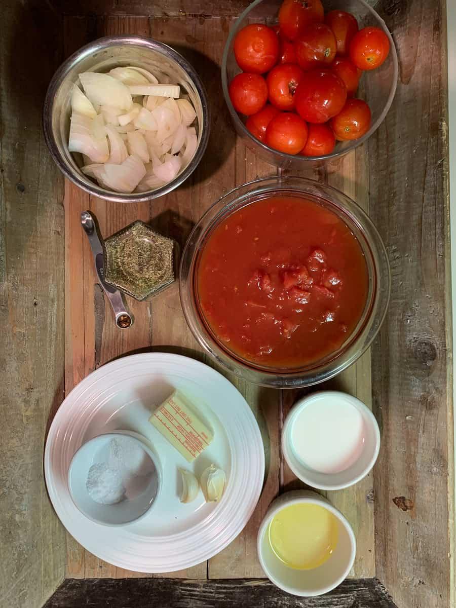 tomato soup ingredients onion, tomatoes, oregano, salt, butter, olive oil, milk, garlic, salt