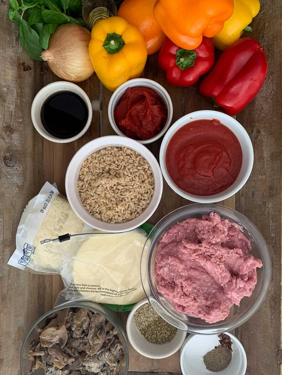ingredients for stuffed bell pepper on wooden tray